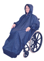 Lady wearing hooded Blue Wheelchair Mac with sleeves