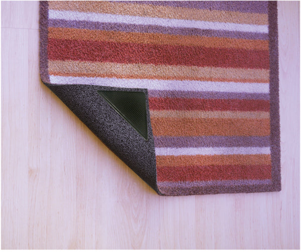 Striped rug with Rug Stop attached to folded up corner