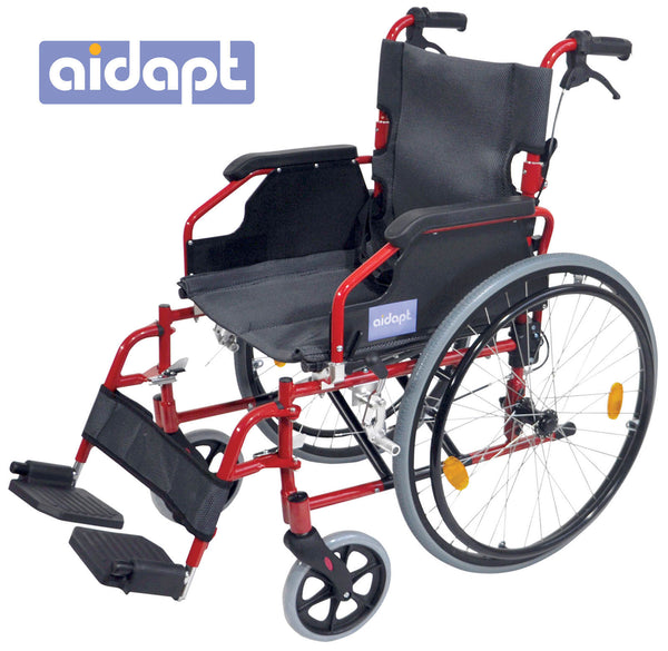 Red framed self propelled wheelchair with black seat and footrest