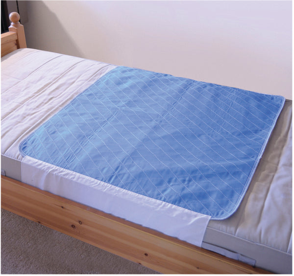 Bed made with blue waterproof bed mat with flaps