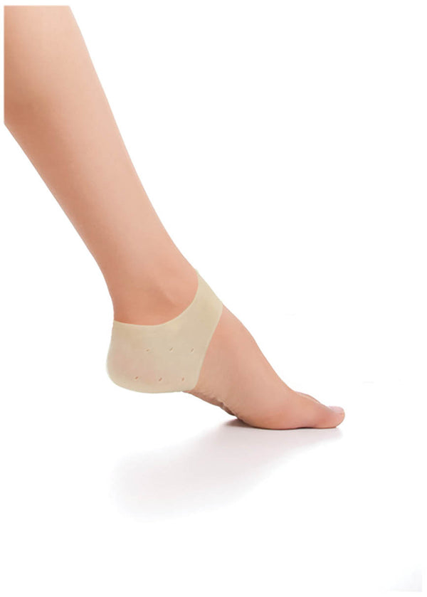 Woman wearing a heel protector against white background