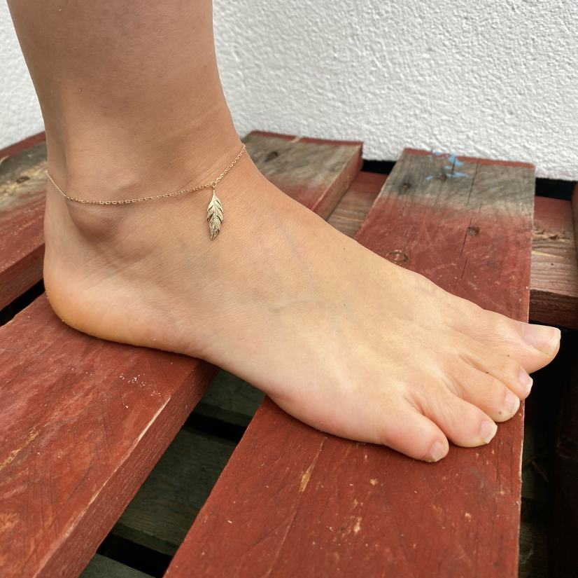 Burren Jewellery 18k gold plate Leaf It Out Anklet on ankle
