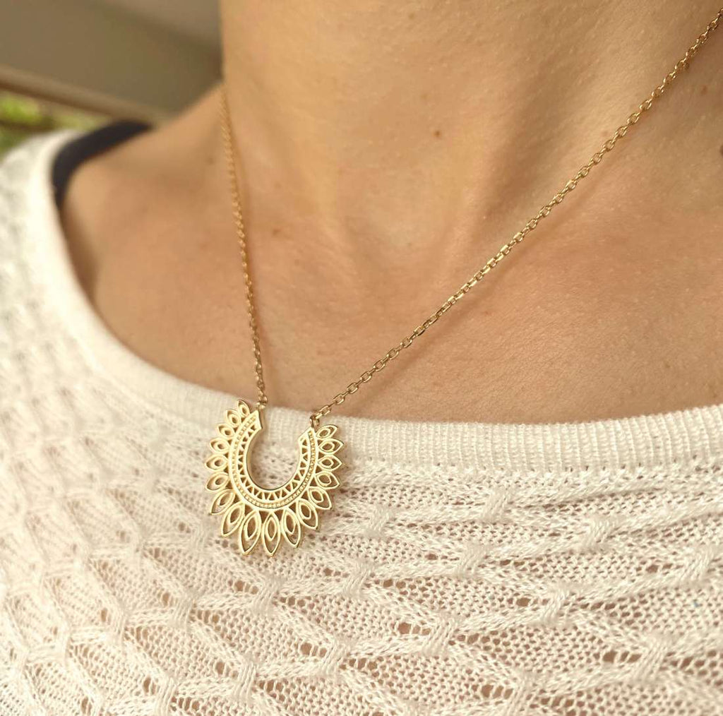 Burren Jewellery 18k gold plate Open Flame Necklace on neck