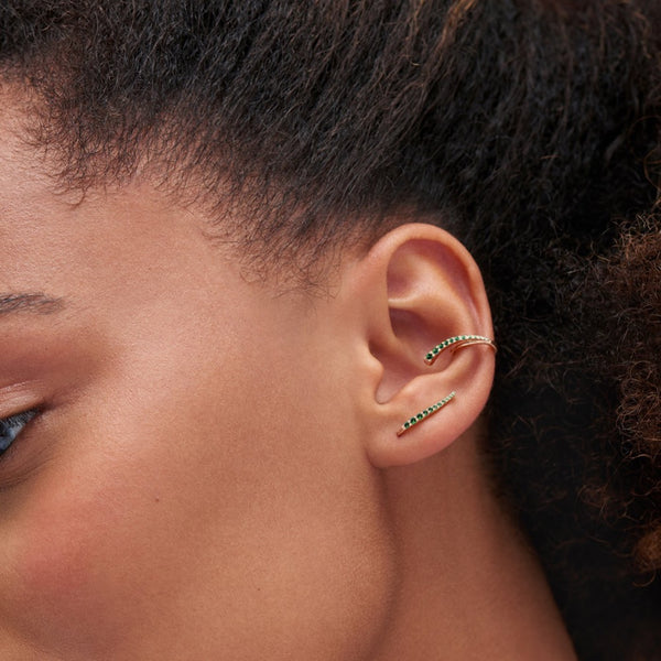 Serena wearing emerald ear cuff and ear jewel