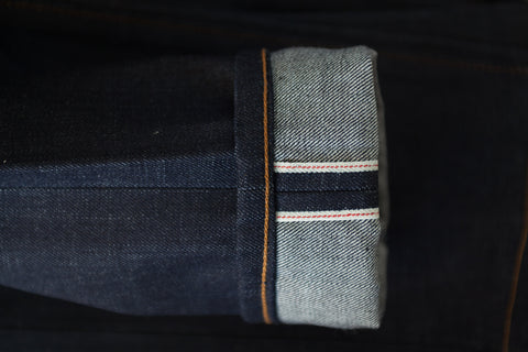 Cone Mills Red Line 130z raw selvedge indigo denim. Made in USA