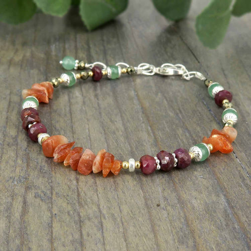 Confidence boosting healing crystal bracelet with sunstone, ruby, pyrite, green aventurine and sterling silver