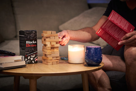 a man playing blocks of desire, an intimate board game for gay men