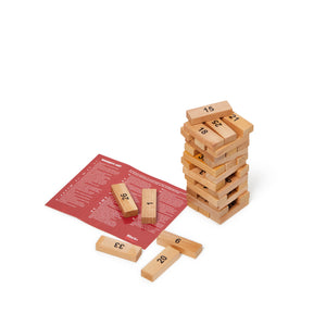 small tower of wooden blocks and brochure of naughty gay sex moves and romantic questions
