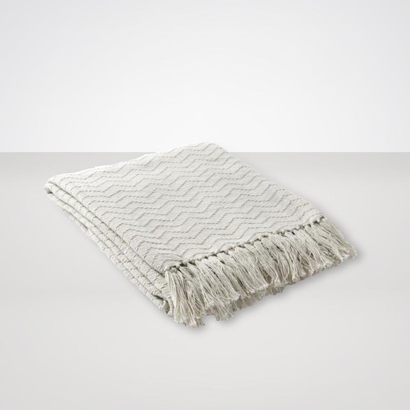 Thelma Throw Blankets in Cream Color