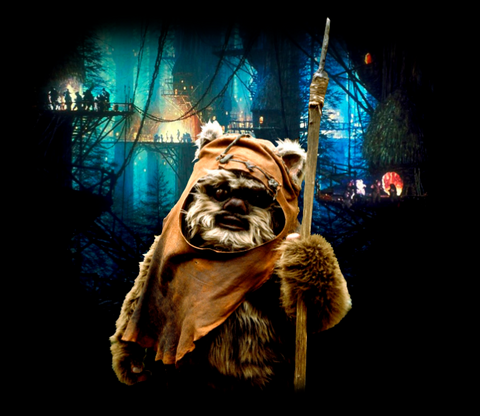 Wicket stands holding his spear with his tree village behind him