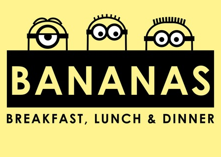 "Three minions peek out from a bananas sign with ""Bananas Breakfast, Lunch, & Dinner"" underneath"
