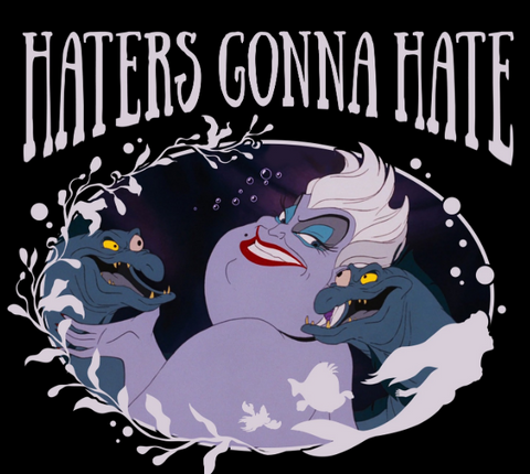 "Ursula with Flotsam and Jetsam on either side of her. She gives an evil grin with the text, ""haters gonna hate"" above her"