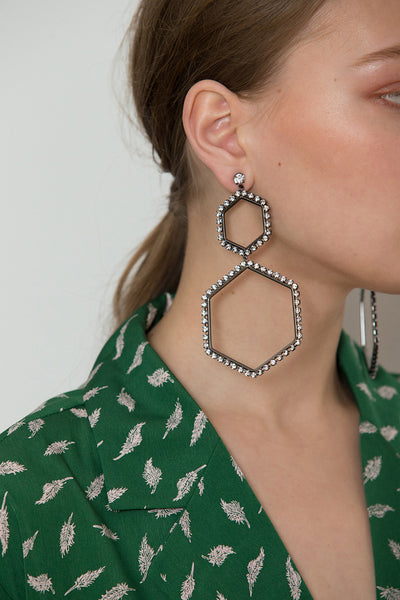 The Abaca Earring, a pair of diamond-shaped earring in Sliver. Post back. Sold as a set.