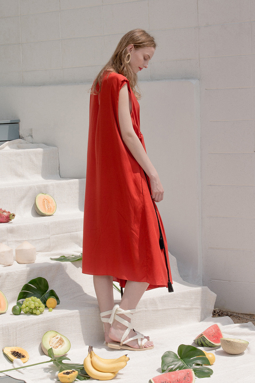 The Allen dress in boat neckline, sleeveless, adjustable cinching waist detailing with self sash belt. Pull on.