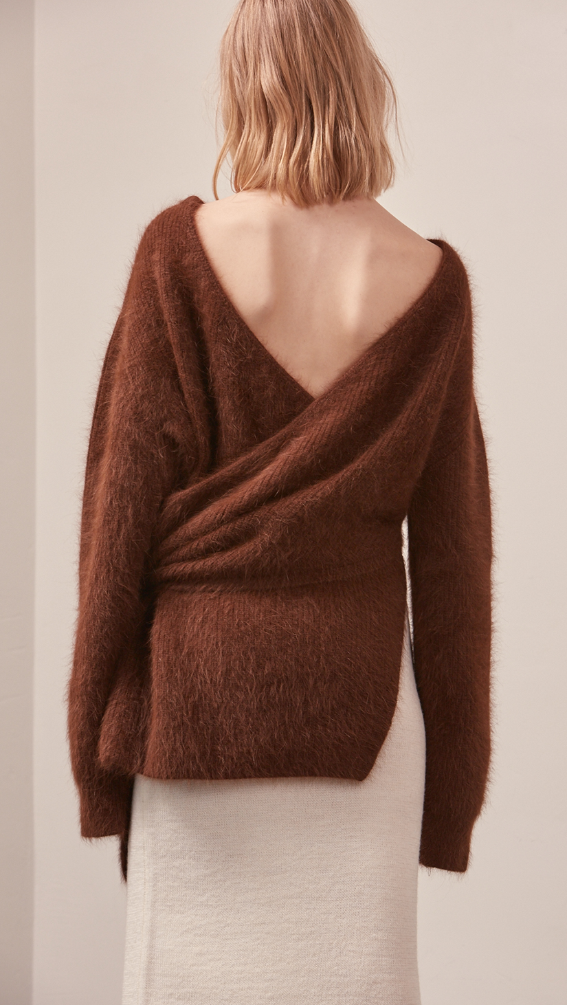 The Amuza Sweater in dark brown. Features chunky knit wrap-style sweater in dark brown alpaca and angora blend. Long sleeves, V-neckline (can be styled backward), self-tie wraps front around the waist, side slits. Pull on. Mid-weight. Oversized silhouette.