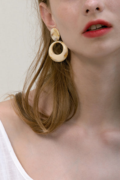The Angia, a pair of acutate round drop earrings. Metal post back. Sold as a set.