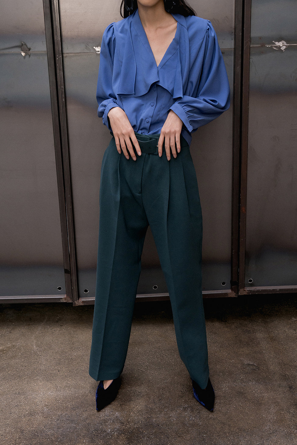The Anje Pant featuring detachable belted with pleats, slant two pockets. Concealed front zip closure. Sewn-down pleats at front. Straight leg.