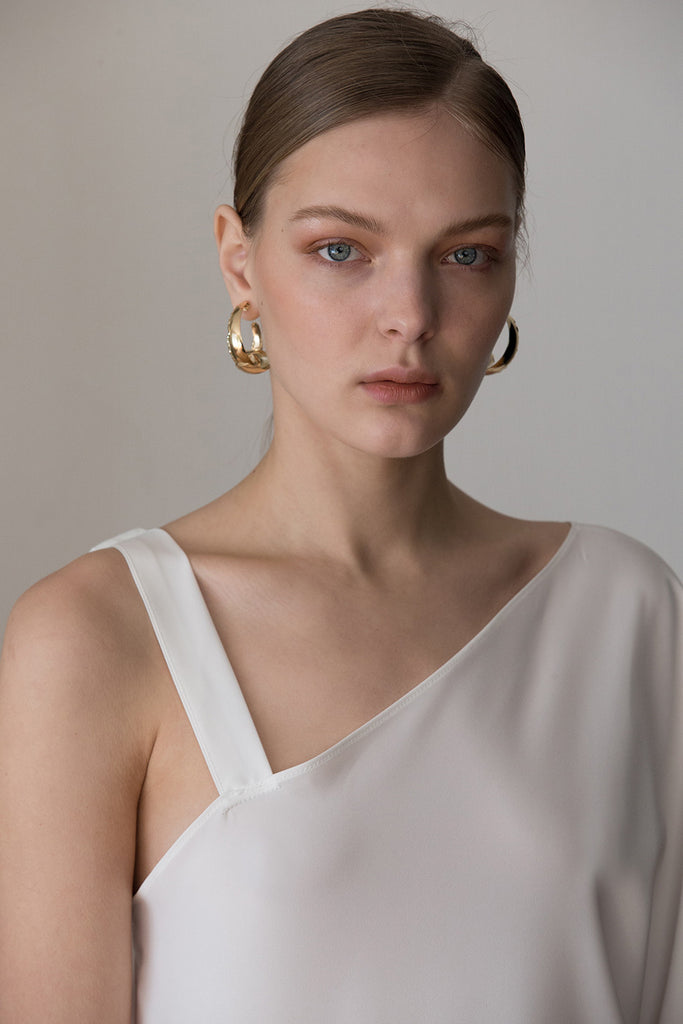 The Anzi Earring, a pair of delicate hug earring. Post back. Sold as a set.