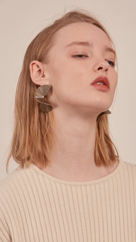 The Arley, a pair of sculptural gold-plated earring. Post back.