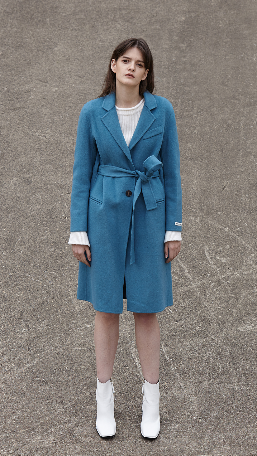 The Arya Coat is cut for a long-line silhouette that falls just below the knee. With a single-button fasting along front. Use the self-tie belt to flatter and define your waistline. Handmade.