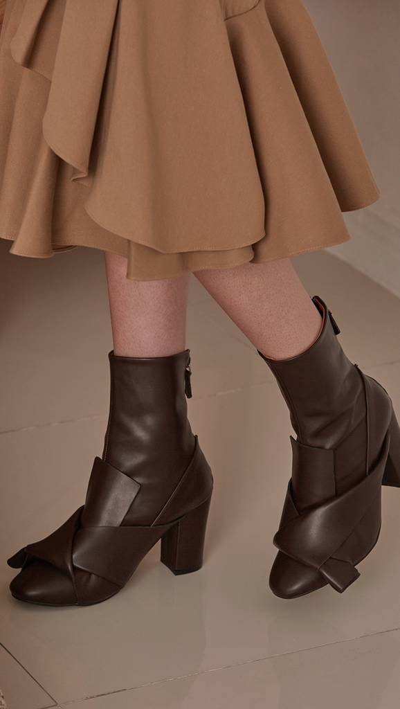 Atala Midi Boots in Dark Brown. Soft synthetic there upper, slouchy design in gathered origami top, almond toe and zip opening at back.