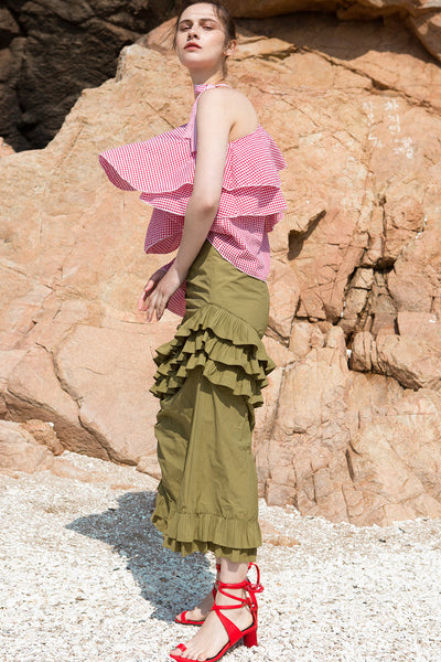 The Aurélie Skirt in Khaki featuring layered ruffles and cut on a bias. Asymmetrical hem. Concelaed side zip closure. Layered ruffles. Partial lined. High rise.