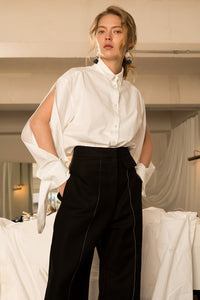 The Azour Shirt in Off White, featuring classic button down, pointed collar, voluminous deep slits sleeves with barrels cuff detail, single-button angle cuff.