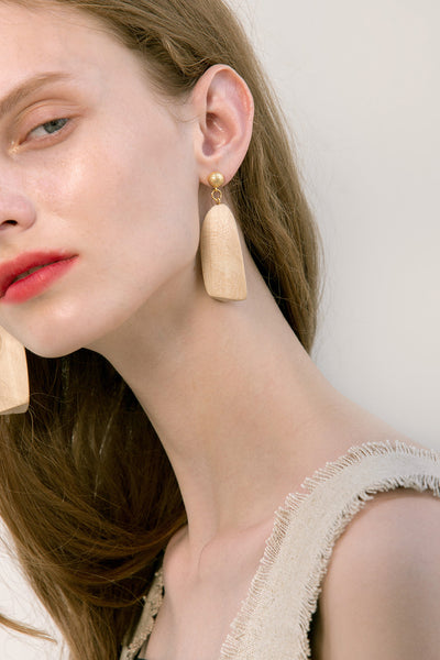 The Besa, a pair of wooden earring. Gold metal post back. Sold as a set.