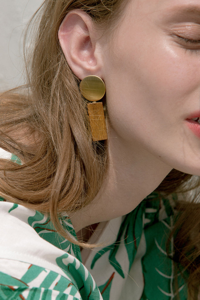 The Boule, a pair of interlocked wood and brass components earrings. Gold metal post back. Sold as a set.