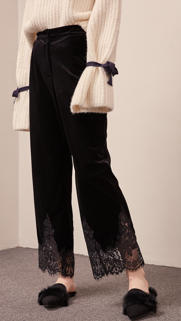 The Capri pant in velvet black with lace hem, hook and zip fly front, gathered elasticated waistband.
