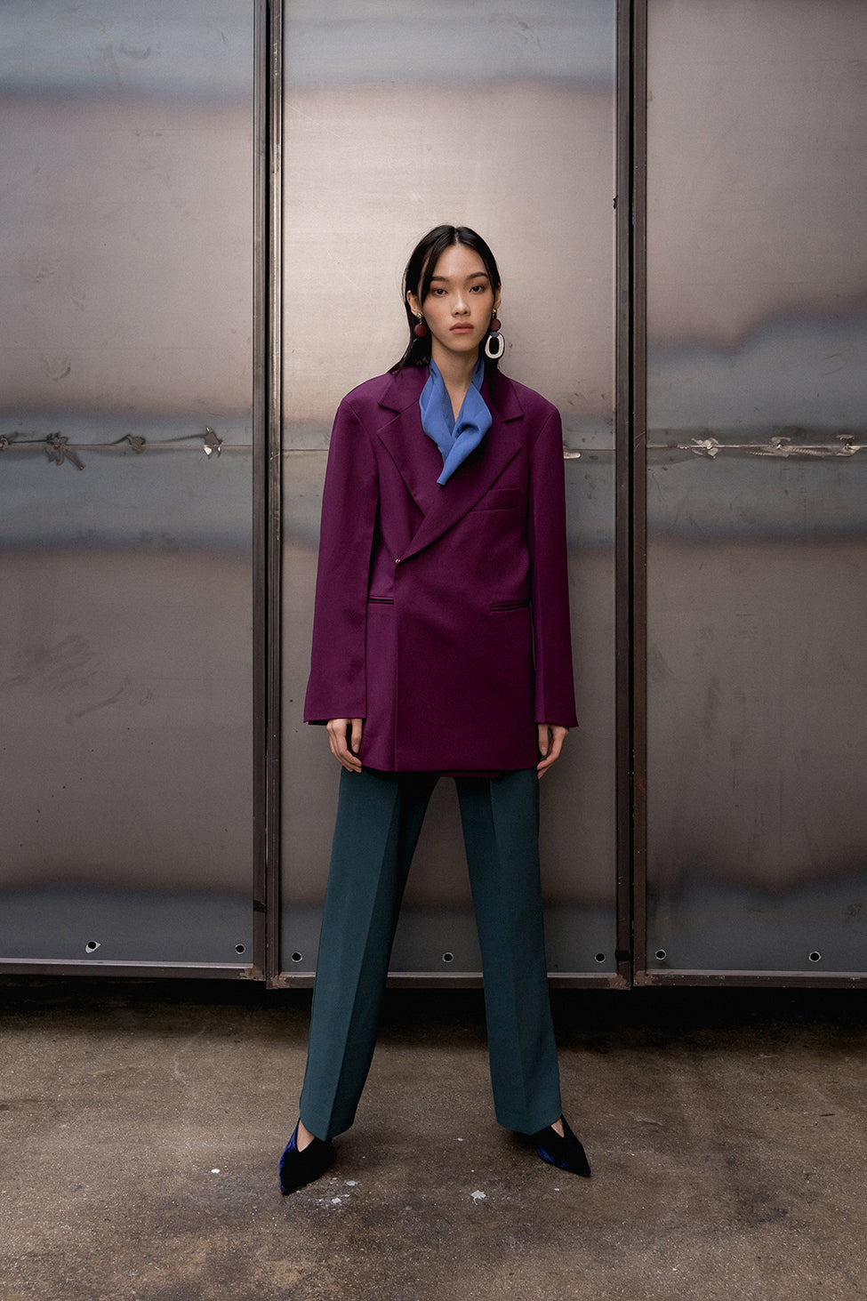 Suit wool jacket from Carlotta Jacket in deep violet. Notch lapel. Dropped shoulders. Left chest pocket. Long sleeves with slits at cuff. Hook and eye closure at front.