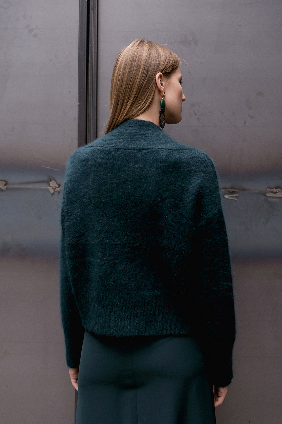 The Cecily angora sweater, long sleeved pullover with deep V-neck in forest green wool blend. Dropped shoulder.