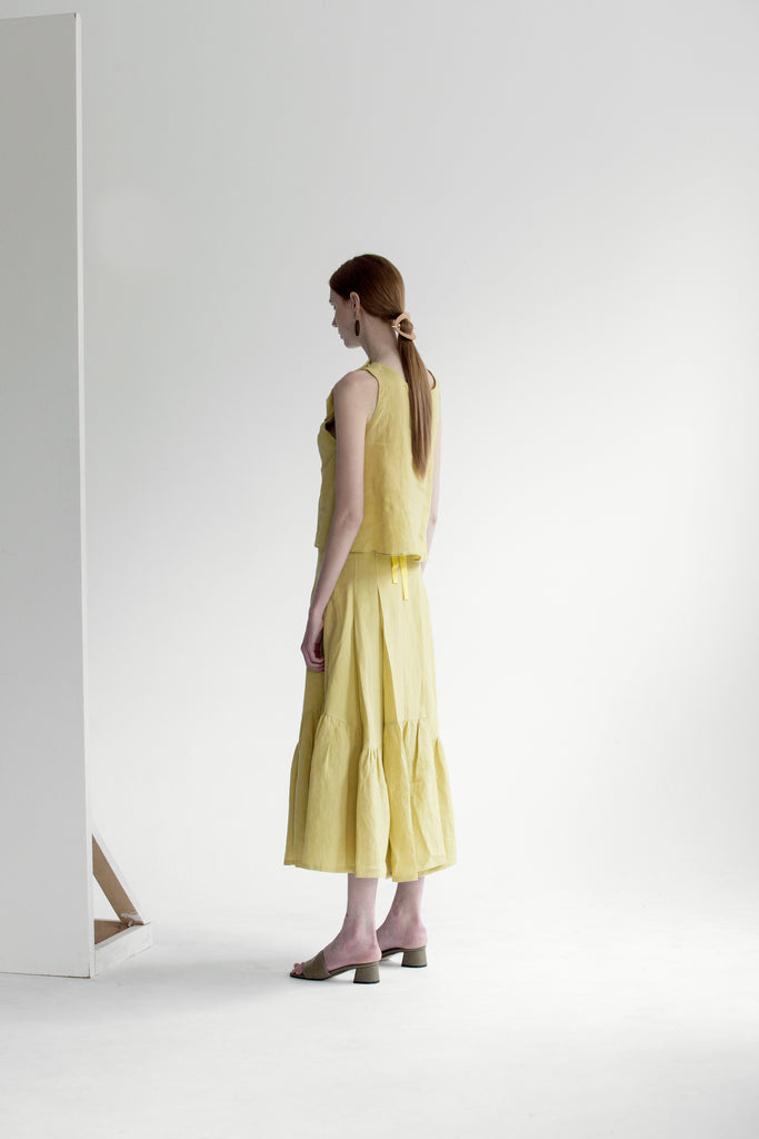 The Dhara Skirt in Chartreuse featuring ruffle pleats in fluted edge, concealed size zip closure, high waist in ankle length.