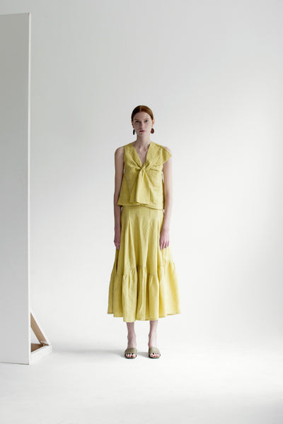 The Dhara Top in Chartreuse featuring sleeveless, V-neckline, front tuck detailing. Pull on.