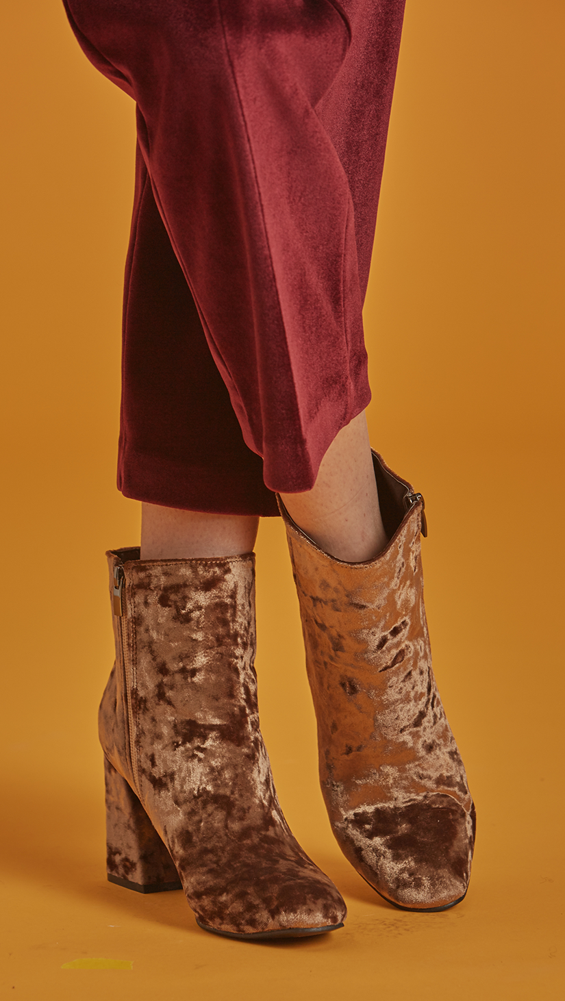 The Dillon is lustrous moss-yellow velvet ankle boots with matching velvet-covered blocked heel. Almond toe, side zip fastening. Second-skin silhouette. Ankle length.
