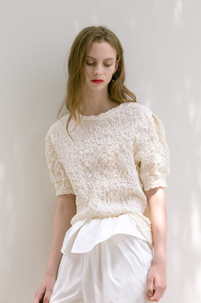 The Farrah in Ivory featuring ruched detailing, quarter sleeves with puffs. Pull on