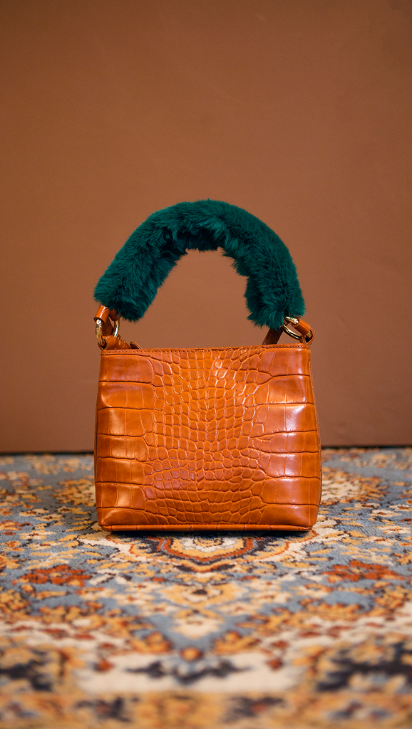 Forziéri bag in brown/deep green. Fur handle, front flap magnetic snap tab closure. Interior pockets. Detachable shoulder straps. Structured bottom.