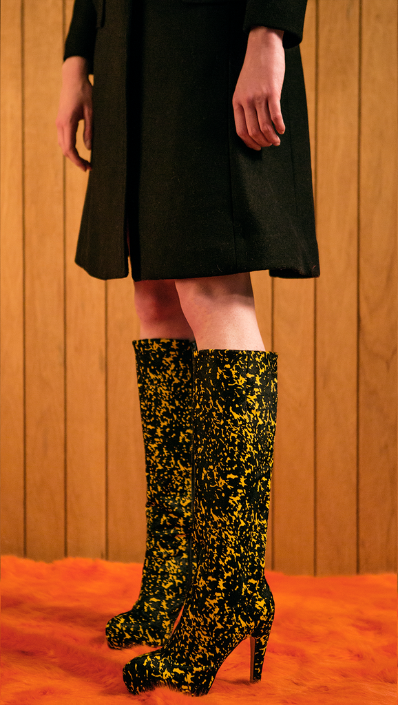 The Gaucho Knee Boots in yellow/black graphic. Zip fastening along side. Knee length.