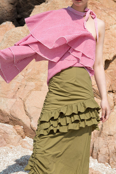 Architectural top from pink gingham stripes. Asymmetric neckline with self tie detail at side neck. Exaggerated ruffle panel at one shoulder sleeve.