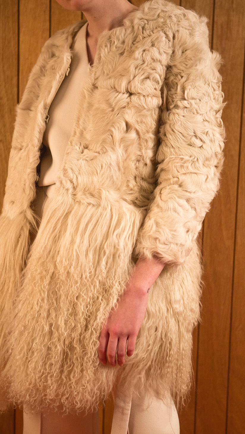 Heavy cream lamb-fur coat in timelessly chic style, fuzzy ivory mongolian-lamb fur hemline. Cropped length in sleeves, collarless, open-style with hook-and-eye closure. Mid-weight. Fully lined. Oversized. Straight cut.