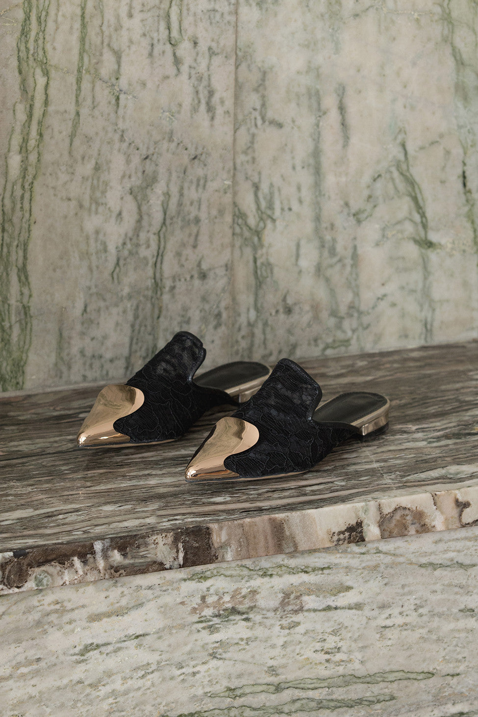 The Helios featuring an almond toe with gold brass detail in Black. Lightly padded footbed.