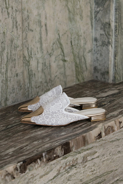 The Helios featuring an almond toe with gold brass detail in White. Lightly padded footbed.