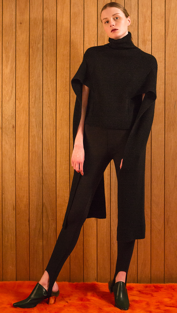 The Hensley is a sweater in extra long length sleeves. Poncho-style, ribbed knit in turtleneck. Light-weight.