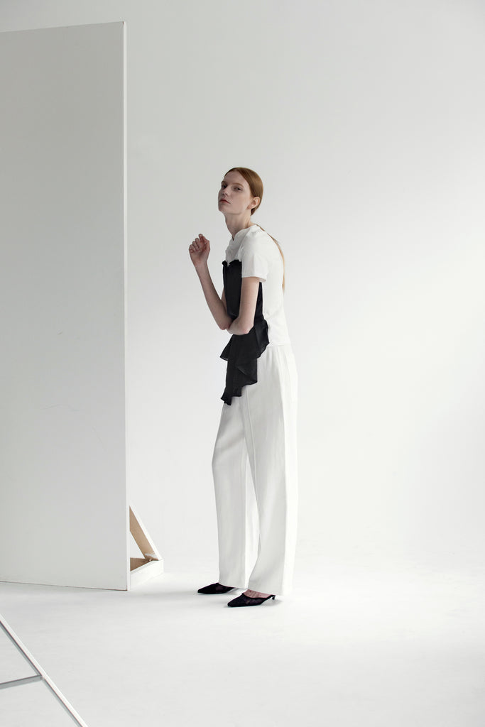 Tee shirt inspired Harvey Top in short sleeve with boat neckline, folded asymmetric origami bodice detailing. Pull on.