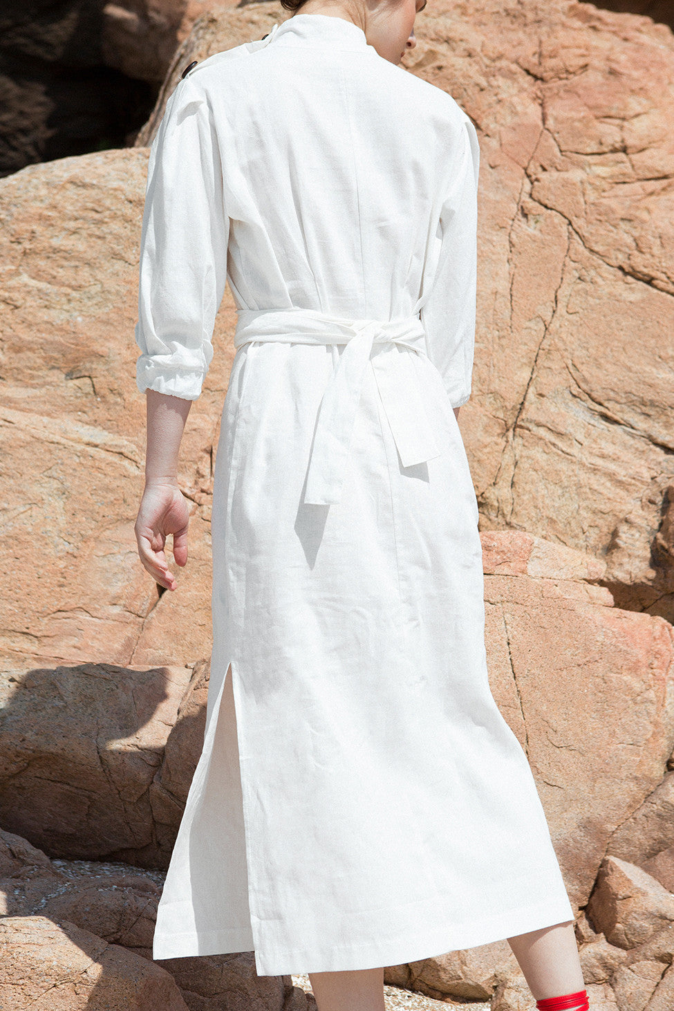 The Holland Dress featuring square neckline with oversized wood buttons, 3/4 sleeves with ruched cuffs, unmovable self tie belt, side slits. Pull on.