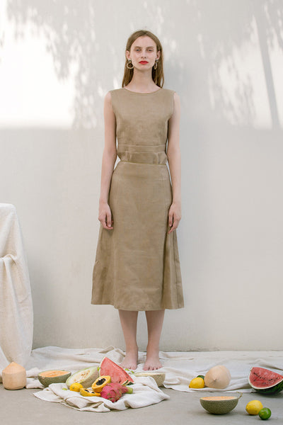 The Janelle Skirt in Beige featuring pleated waist, ankle length. Straight hem. Concealed zip fastening at back.