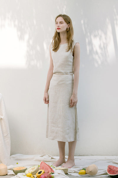 The Janelle Skirt in Ivory featuring pleated waist, ankle length. Straight hem. Concealed zip fastening at back.