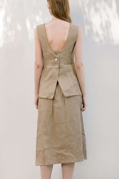 The Janelle Top in Beige featuring sleeveless tank top, deep U-neckline at back, button down closure at back.