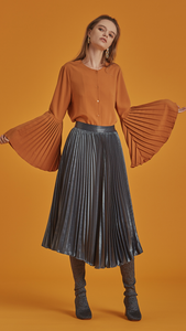 The Janye is a button-down blouse in non-sheer belled sleeves with accordion pleats. With a cowl neckline, slightly loose bodice and extra long sleeves.