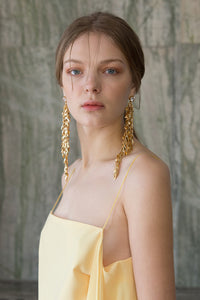 The Jupe, a pair of drop earrings in Gold. Delicate chain design with cubic stud. Post back. Sold as a set.